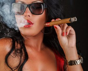 black woman with black sunglasses smoking cigar